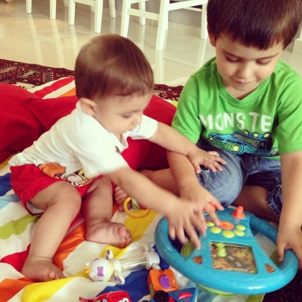 Luca being good and showing his brother how to play